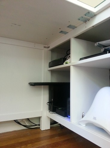 Here's where the back meets the sofa table - secured at the back and at the top where the desktop meets