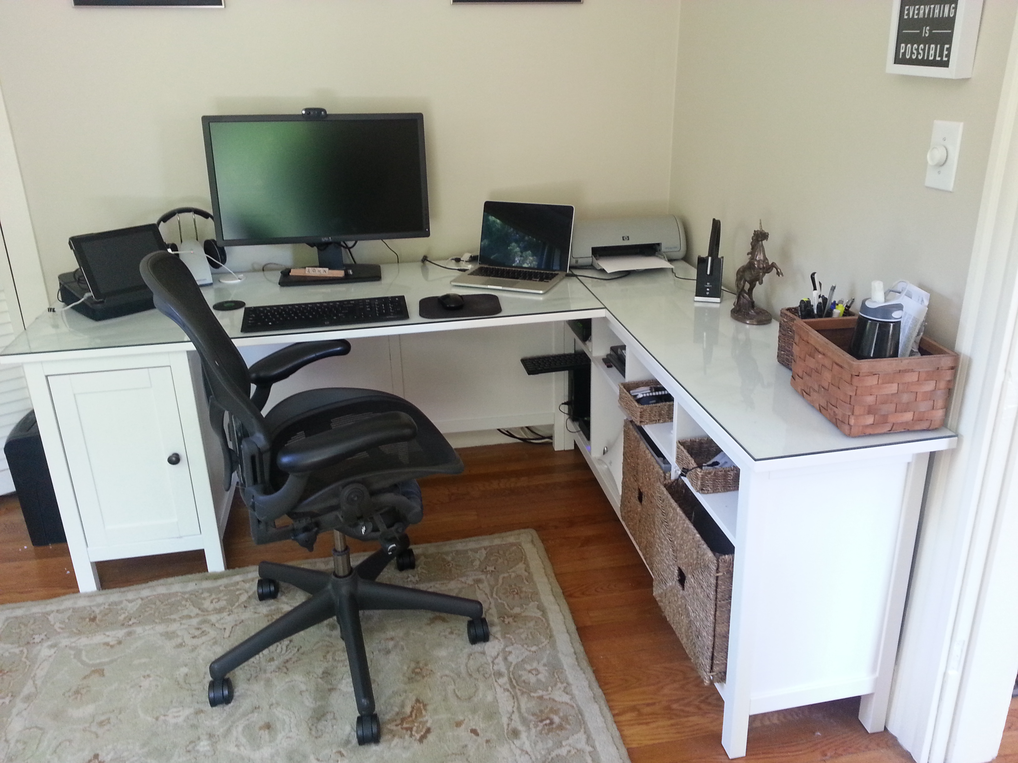 corner desk home office. hemnes desk minus one pedestal, plus sofa table, glass top. corner home office